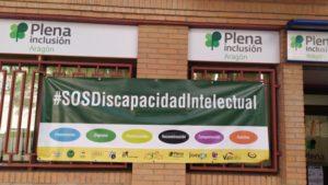 Pancarta reivindicativa de Plena inclusión Aragón
